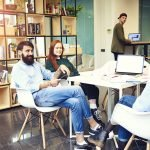 Skilled male and female in coworking